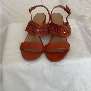 Dark orange-copper colored sandals